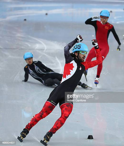 Gold medalist Charles Hamelin of Canada celebrates after wiining the Short Track Men's 1500m Final on day 3 of the Sochi 2014 Winter Olympics at...