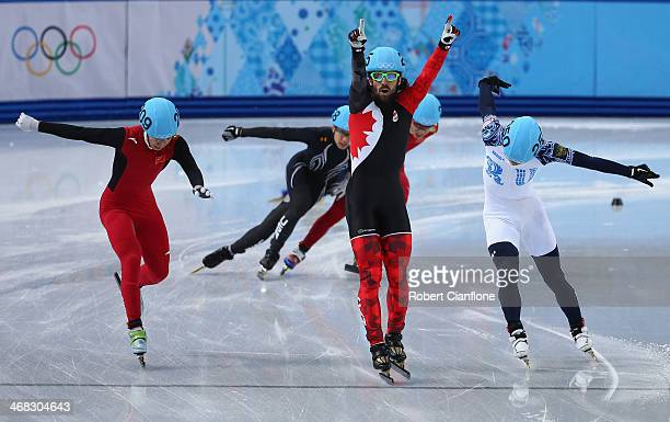 Gold medalist Charles Hamelin of Canada celebrates after winning the Short Track Men's 1500m Final on day 3 of the Sochi 2014 Winter Olympics at...