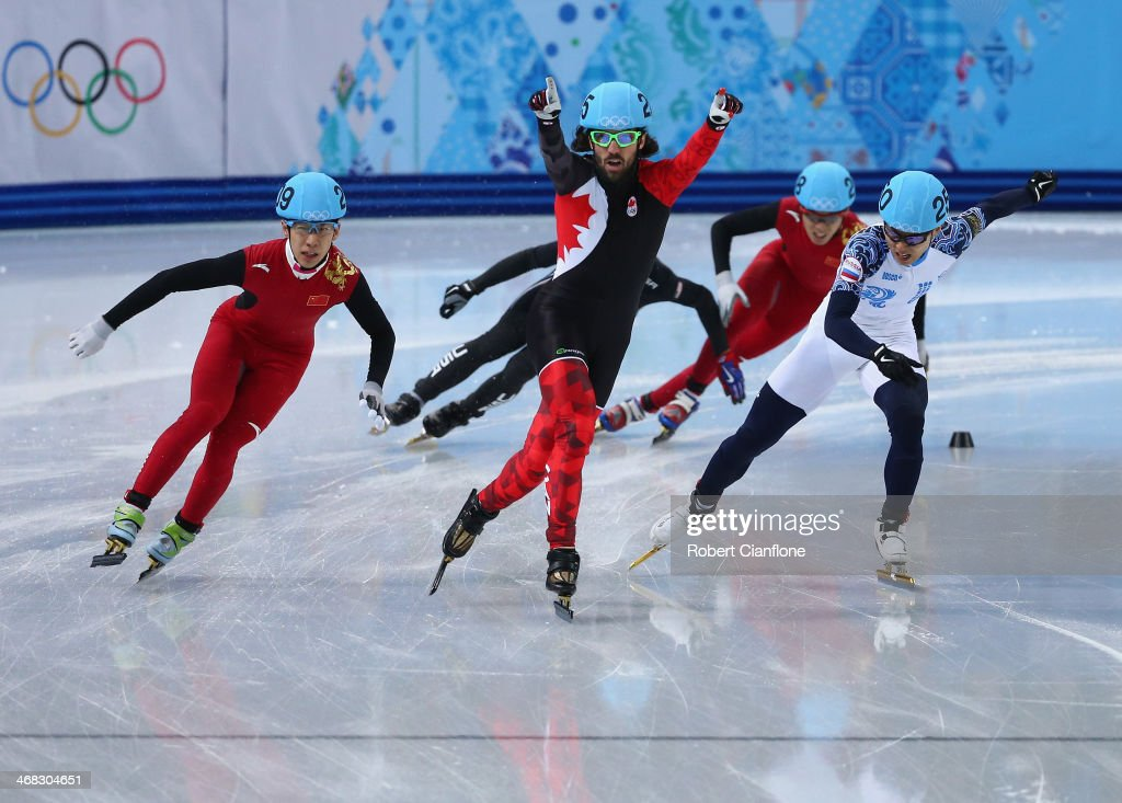 Gold medalist Charles Hamelin of Canada celebrates after winning the Short Track Men's 1500m Final on day 3 of the Sochi 2014 Winter Olympics at Iceberg Skating Palace on February 10, 2014 in Sochi, Russia.