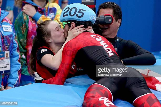 Gold medalist Charles Hamelin of Canada celebrates by kissing Marianne StGelais qafter wiining the Short Track Men's 1500m Final on day 3 of the...