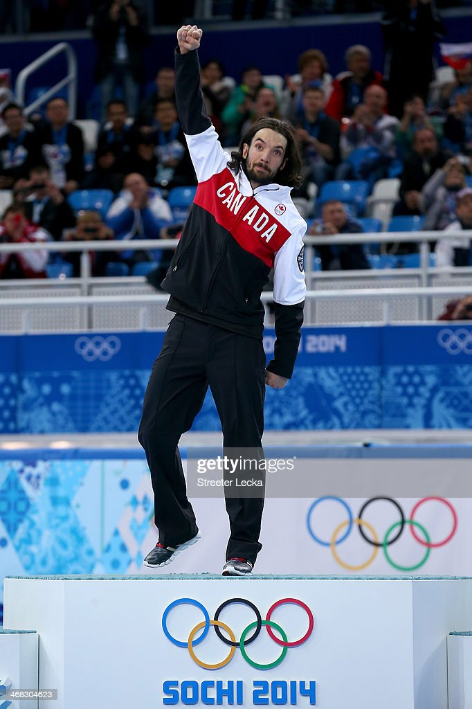 Gold medalist Charles Hamelin of Canada celebrates during the flower ceremony for the Short Track Men's 1500m Final on day 3 of the Sochi 2014 Winter Olympics at Iceberg Skating Palace on February 10, 2014 in Sochi, Russia.