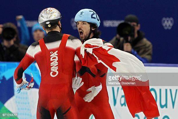 Gold medalist Charles Hamelin of Canada celebrates with bronze medalist FrancoisLouis Tremblay of Canada in the Men's 500m Short Track Speed Skating...