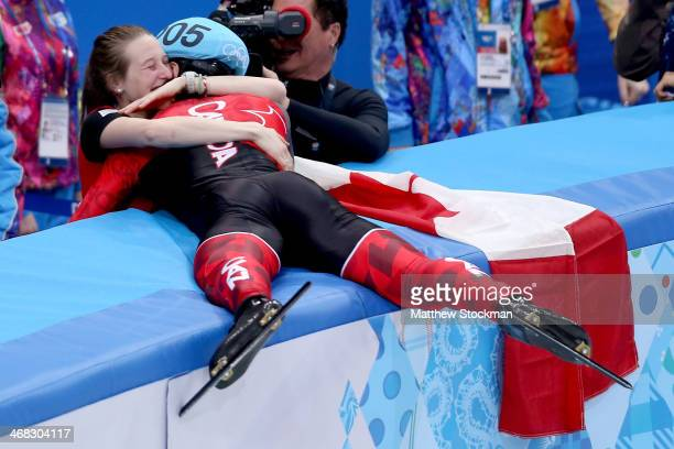 Gold medalist Charles Hamelin of Canada celebrates with Marianne StGelais after wiining the Short Track Men's 1500m Final on day 3 of the Sochi 2014...