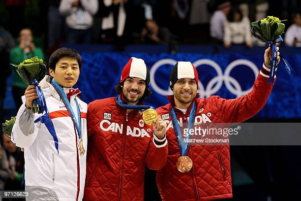 Gold medalist Charles Hamelin of Canada celebrates with silver medalist Sung SiBak and bronze medalist FrancoisLouis Tremblay of Canada in the Men's...