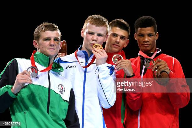 Gold medalist Charlie Flynn of Scotland poses with silver medalist Joe Fitzpatrick of Northern Ireland and bronze medalists Joseph Cordina of Wales...
