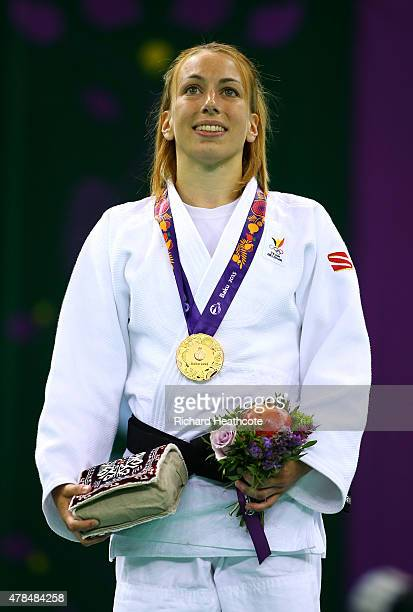 Gold medalist Charline van Snick of Belgium poses on the medal podium following the Women's Judo 48kg Finals during day thirteen of the Baku 2015...