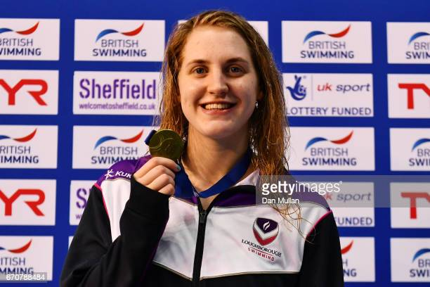 Gold medalist Charlotte Atkinson of Loughboro Uni poses with the medal won competes in the Womens Open 200m Butterfly final on day three of the...