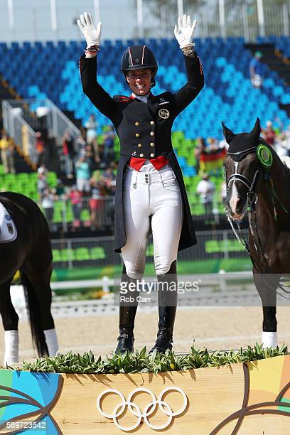 Gold medalist, Charlotte Dujardin of Great Britain riding Valegro celebrates on the podium during the medal ceremony during the Dressage Individual...