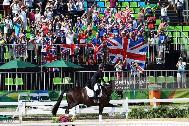 Gold medalist, Charlotte Dujardin of Great Britain riding Valegro celebrates during the medal ceremony during the Dressage Individual Grand Prix...