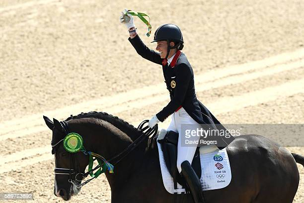 Gold medalist, Charlotte Dujardin of Great Britain riding Valegro celebrates during the medal ceremony after winning the Dressage Individual Grand...