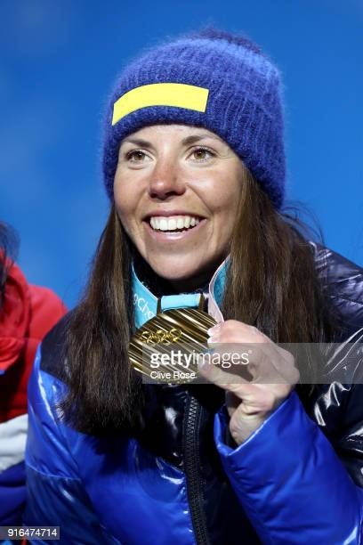 Gold medalist Charlotte Kalla of Sweden celebrates during the Medal Ceremony for the CrossCountry Skiing Ladies' 75km 75km Skiathlon on day one of...