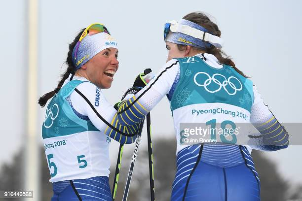 Gold medalist Charlotte Kalla of Sweden celebrates with Ebba Andersson of Sweden during the Ladies Cross Country Skiing 75km 75km Skiathlon on day...