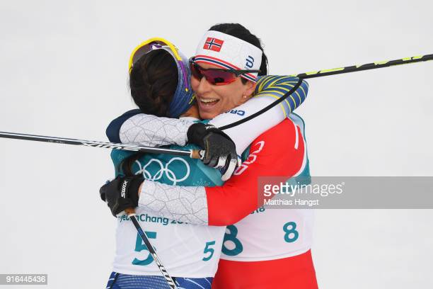 Gold medalist Charlotte Kalla of Sweden celebrates with silver medalist Marit Bjoergen of Norway after the Ladies Cross Country Skiing 75km 75km...