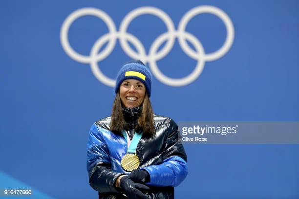 Gold medalist Charlotte Kalla of Sweden poses with her gold medal during the Medal Ceremony for the CrossCountry Skiing Ladies' 75km 75km Skiathlon...