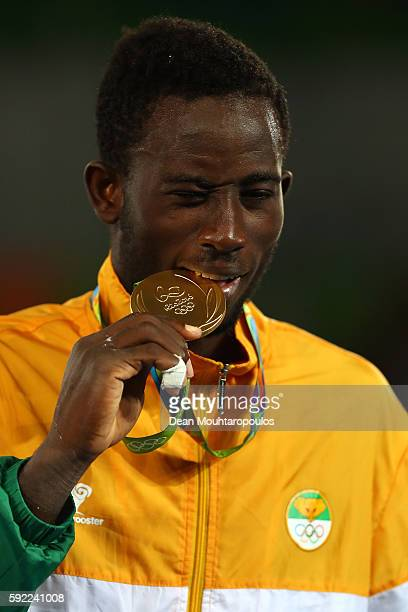 Gold medalist Cheick Sallah Cisse of Cote d'Ivoire poses on the podium during the medal ceremony for the Men's Taekwondo 80kg Contest on Day 14 of...
