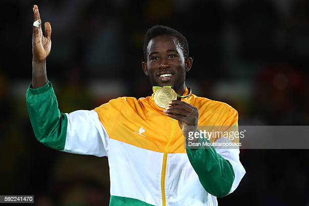 Gold medalist Cheick Sallah Cisse of Cote d'Ivoire poses on the podium during the medal ceremony for the Men's Taekwondo -80kg Contest on Day 14 of...