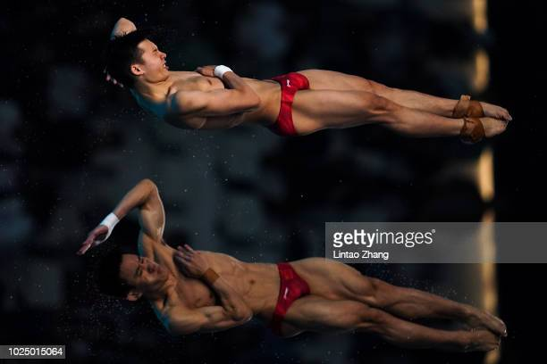 Gold medalist Chen Aisen and Yang Hao of China compete in the Diving Men's Synchronised 10m Platform final at GBK Aquatic Center on day eleven of the...