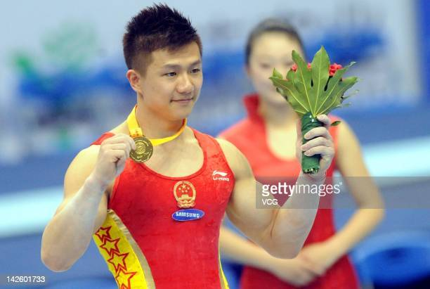 Gold medalist Chen Yibing of China stands on the podium after winning the Rings fainal during the FIG World Cup Zibo 2012 at Zibo Sports Center on...