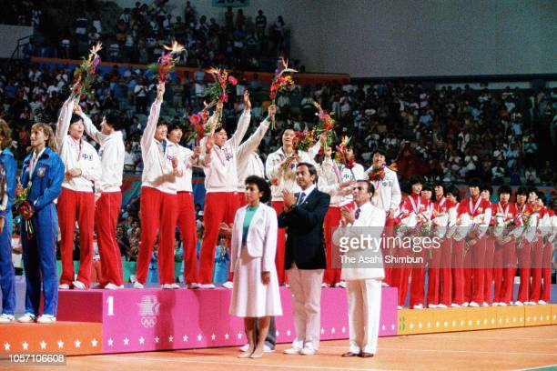 Gold medalist China celebrate on the podium at the medal ceremony for the Volleyball Women's event during the Los Angeles Olympic Games at the Long...