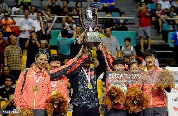 Gold medalist China team celebrate on the podium with the Corbillon Cup trophy during the 2016 World Table Tennis Championship Women's Team Division...