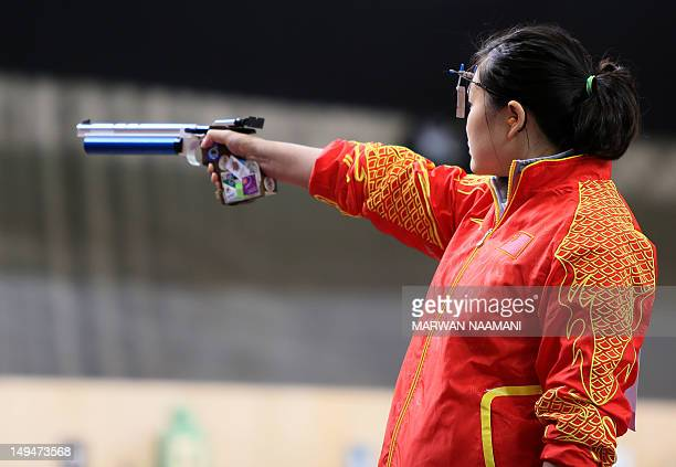 Gold medalist Chinese Guo Wenjun competes in the women's 10m air pistol event at the Royal artillery Barracks in London on July 29 2012 during the...