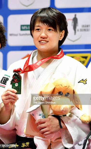 Gold medalist Chizuru Arai of Japan poses for photographs on the podium at the medal ceremony for the Women's 70kg during day five of the World Judo...
