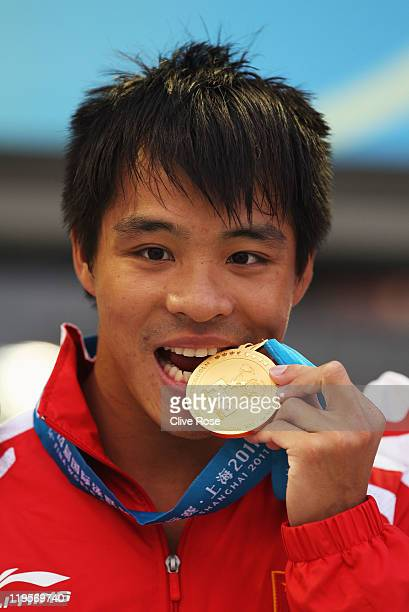 Gold medalist Chong He of China attends the victory ceremony for the Men's 3m Springboard during Day Seven of the 14th FINA World Championships at...