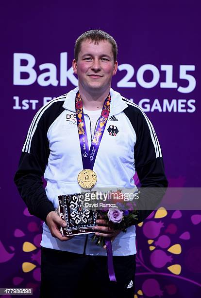 Gold medalist Christian Reitz of Germany poses with the medal won during the Men's Shooting 25m Rapid Fire Pistol on day nine of the Baku 2015...