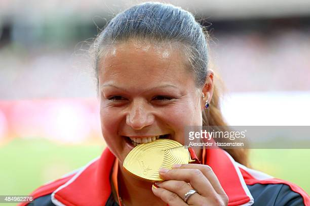 Gold medalist Christina Schwanitz of Germany poses on the podium during the medal ceremony for the Women's Shot Put during day two of the 15th IAAF...