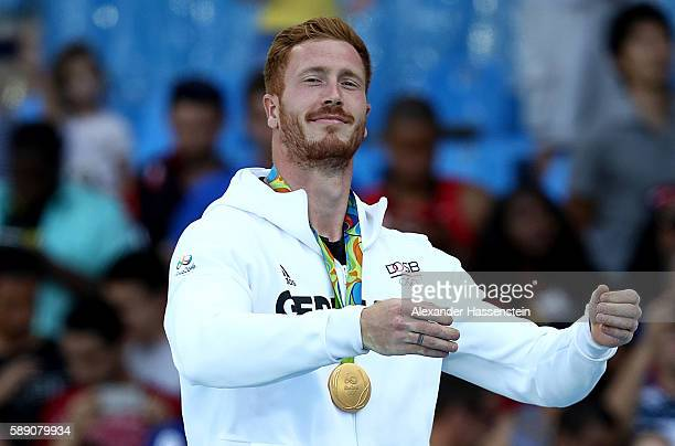 Gold medalist Christoph Harting of Germany poses on the podium during the medal ceremony for the Men's Discus Throw Final on Day 8 of the Rio 2016...