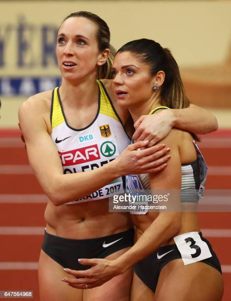 Gold medalist Cindy Roleder of Germany and bronze medalist Pamela Dutkiewicz of Germany celebrate following the Women's 60 metres hurdles final on...