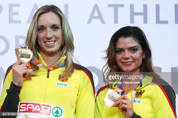 Gold medalist Cindy Roleder of Germany and bronze medalist Pamela Dutkiewicz of Germany pose during the medal ceremony for the Women's 60 metres...