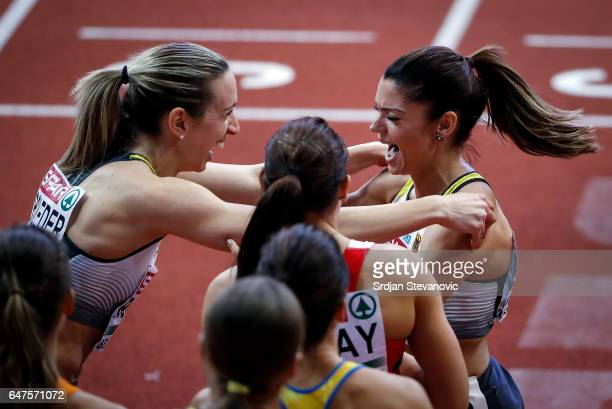 Gold medalist Cindy Roleder of Germany celebrates with bronze medalist Pamela Dutkiewicz of Germany following the Women's 60 metres hurdles final on...