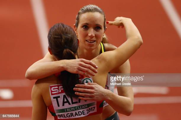 Gold medalist Cindy Roleder of Germany is congratulated by silver medalist Alina Talay of Belrus following the Women's 60 metres hurdles final on day...