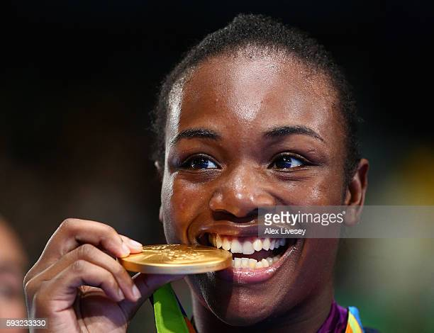 Gold medalist Claressa Maria Shields of the United States poses on the podium during the medal ceremony for the Women's Boxing Middle on Day 16 of...