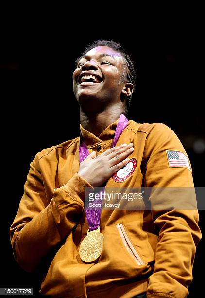 Gold medalist Claressa Shields of the United States celebrates on the podium during the medal ceremony for the Women's Middle Boxing final bout on...