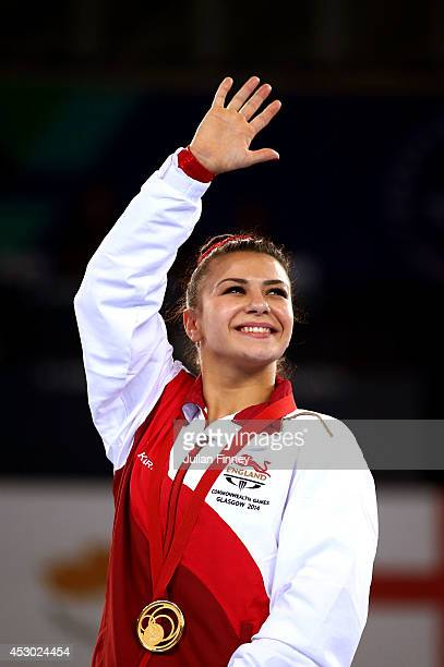 Gold medalist Claudia Fragapane of England celebrates during the medal ceremony for the Women's Floor Final at SSE Hydro during day nine of the...