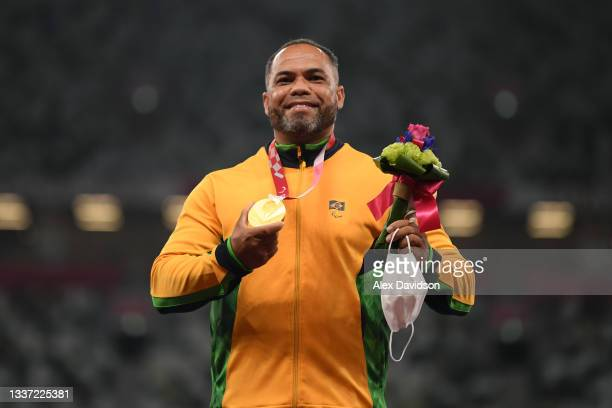 Gold medalist Claudiney Batista dos Santos of Team Brazil poses during the men's Discus Throw - F56 medal ceremony here on day 6 of the Tokyo 2020...