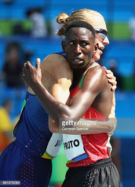 Gold medalist Conseslus Kipruto of Kenya hugs silver medalist Evan Jager of the United States after the Men's 3000m Steeplechase Final on Day 12 of...
