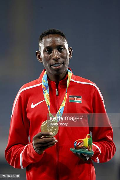 Gold medalist Conseslus Kipruto of Kenya poses during the medal ceremony for the Men's 3000m Steeplechase Final on Day 12 of the Rio 2016 Olympic...