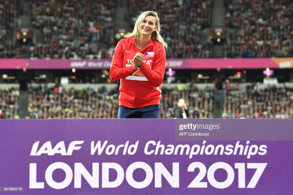 Gold medalist Czech Republic's Barbora potáková poses on the podium during the victory ceremony for the women's javelin throw athletics event at the 2017 IAAF World Championships at the London Stadium in London on August 8, 2017. / AFP PHOTO / Andrej ISAKOVIC