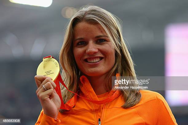 Gold medalist Dafne Schippers of the Netherlands poses on the podium during the medal ceremony for the Women's 200 metres final during day eight of...
