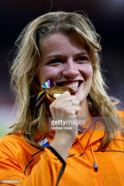 Gold medalist Dafne Schippers of the Netherlands poses with her medal on the podium during the medal ceremony for the Women's 200 metres final during...