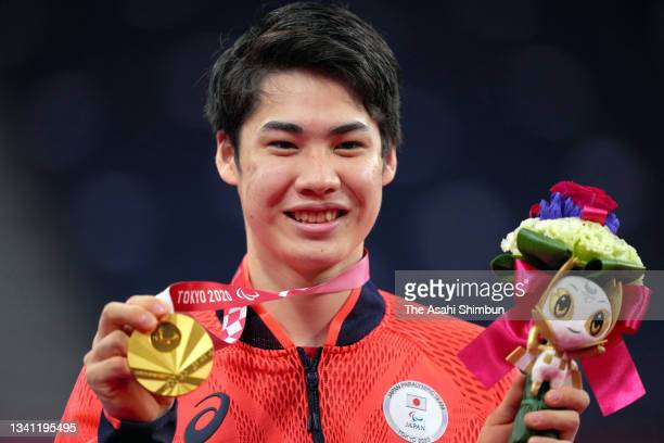 Gold medalist Daiki Kajiwara of Team Japan celebrates on the podium at the medal ceremony for the Badminton Men's Singles WH2 on day 12 of the Tokyo...