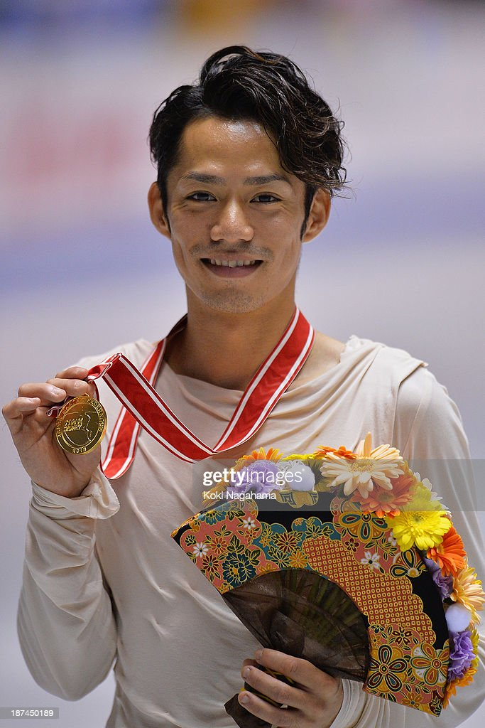 Gold medalist Daisuke Takahashi of Japan poses on the podium during day two of ISU Grand Prix of Figure Skating 2013/2014 NHK Trophy at Yoyogi National Gymnasium on November 9, 2013 in Tokyo, Japan.