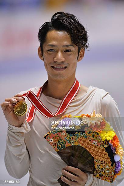 Gold medalist Daisuke Takahashi of Japan poses on the podium during day two of ISU Grand Prix of Figure Skating 2013/2014 NHK Trophy at Yoyogi...