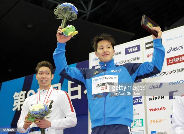 Gold medalist Daiya Seto and silver medalist Kosuke Hagino celebrate on the podium at the medal ceremony for the Men'ss 400m Individual Medley during...