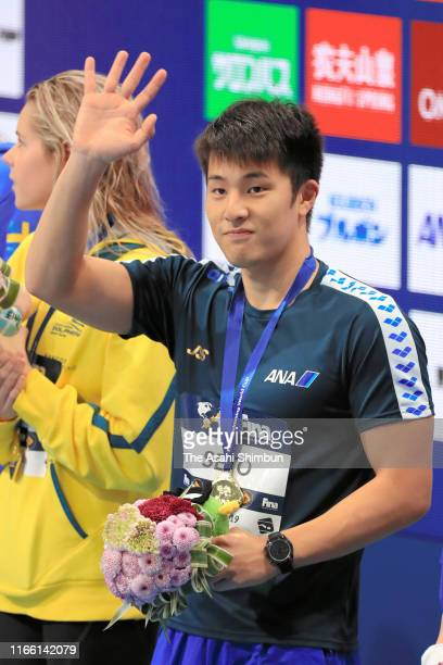 Gold medalist Daiya Seto of Japan waves during the medal ceremony for the Men's 400m Individual Medley on day three of the FINA Swimming World Cup...