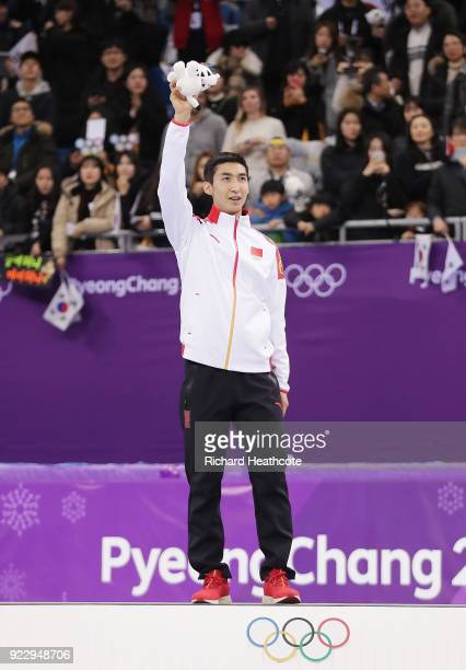Gold medalist Dajing Wu of China celebrates during the victory ceremony after the Short Track Speed Skating Men's 500m Final on day thirteen of the...