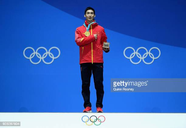 Gold medalist Dajing Wu of China stands on the podium during the medal ceremony for Short Track Speed Skating Men's 500m on day 14 of the PyeongChang...